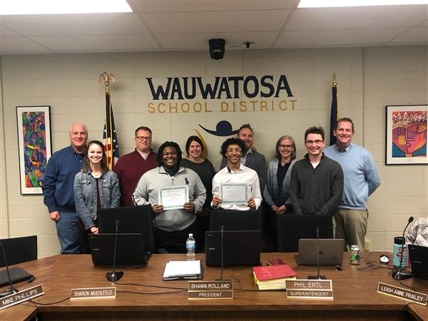 students pose with the Wauwatosa School Board after being recognized
