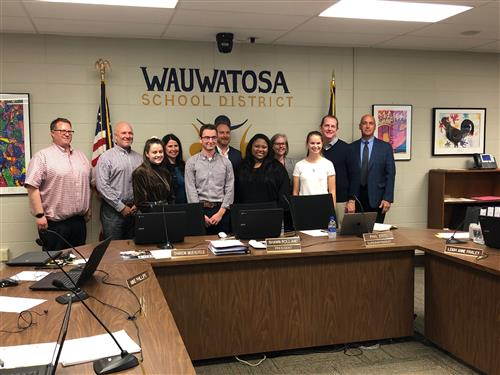 student school board representatives with the board