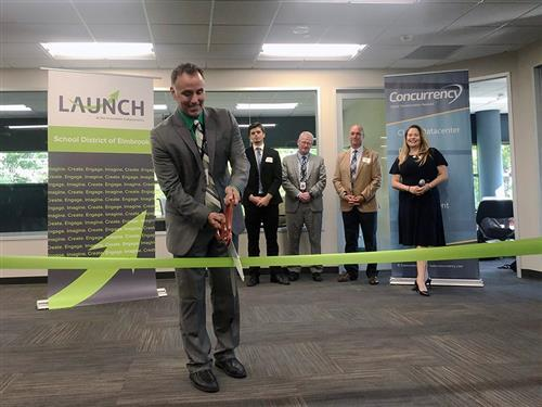 LAUNCH executive director Bob Hall cuts ribbon for new space